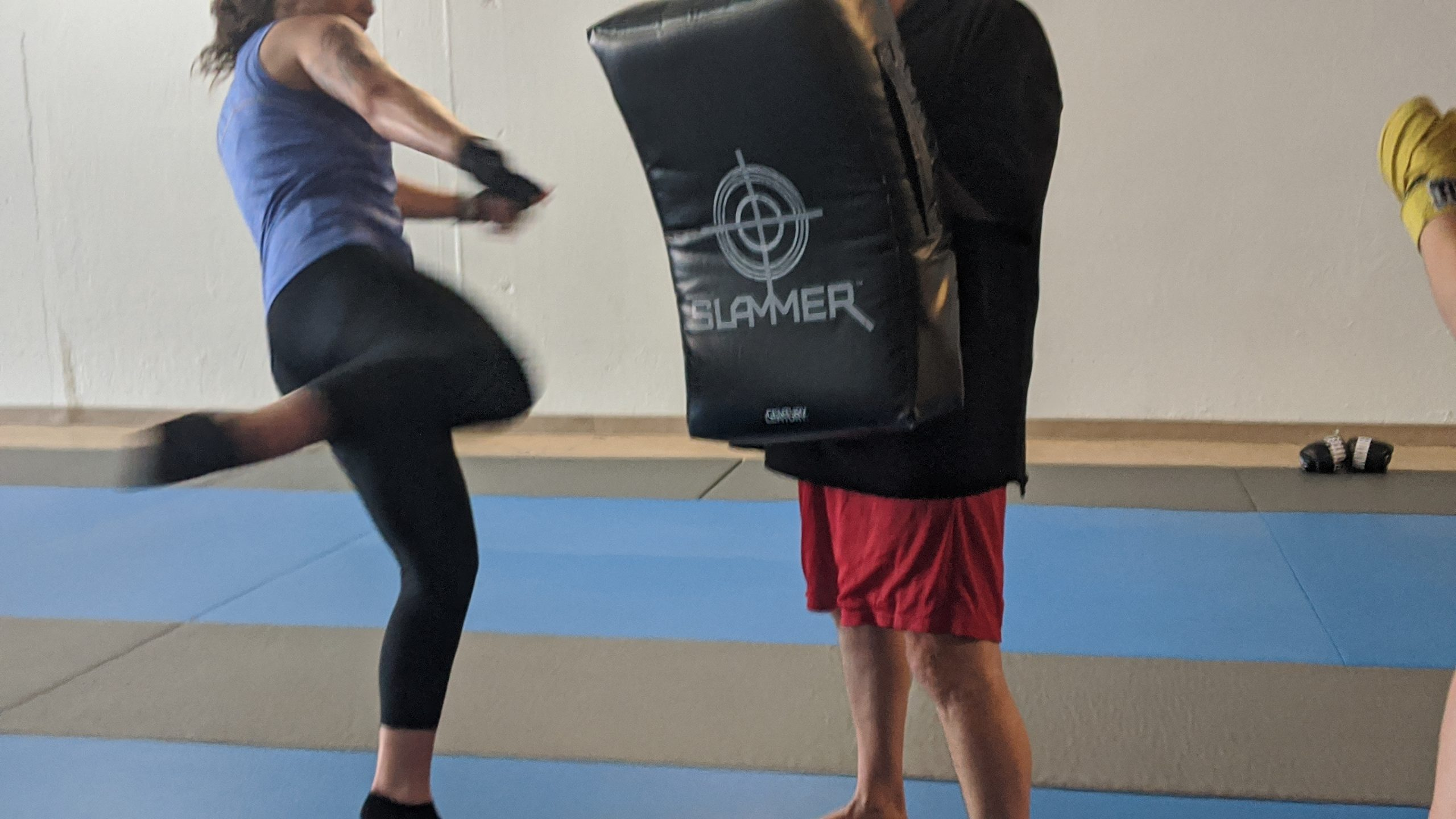 girl kicking a muay thai pad