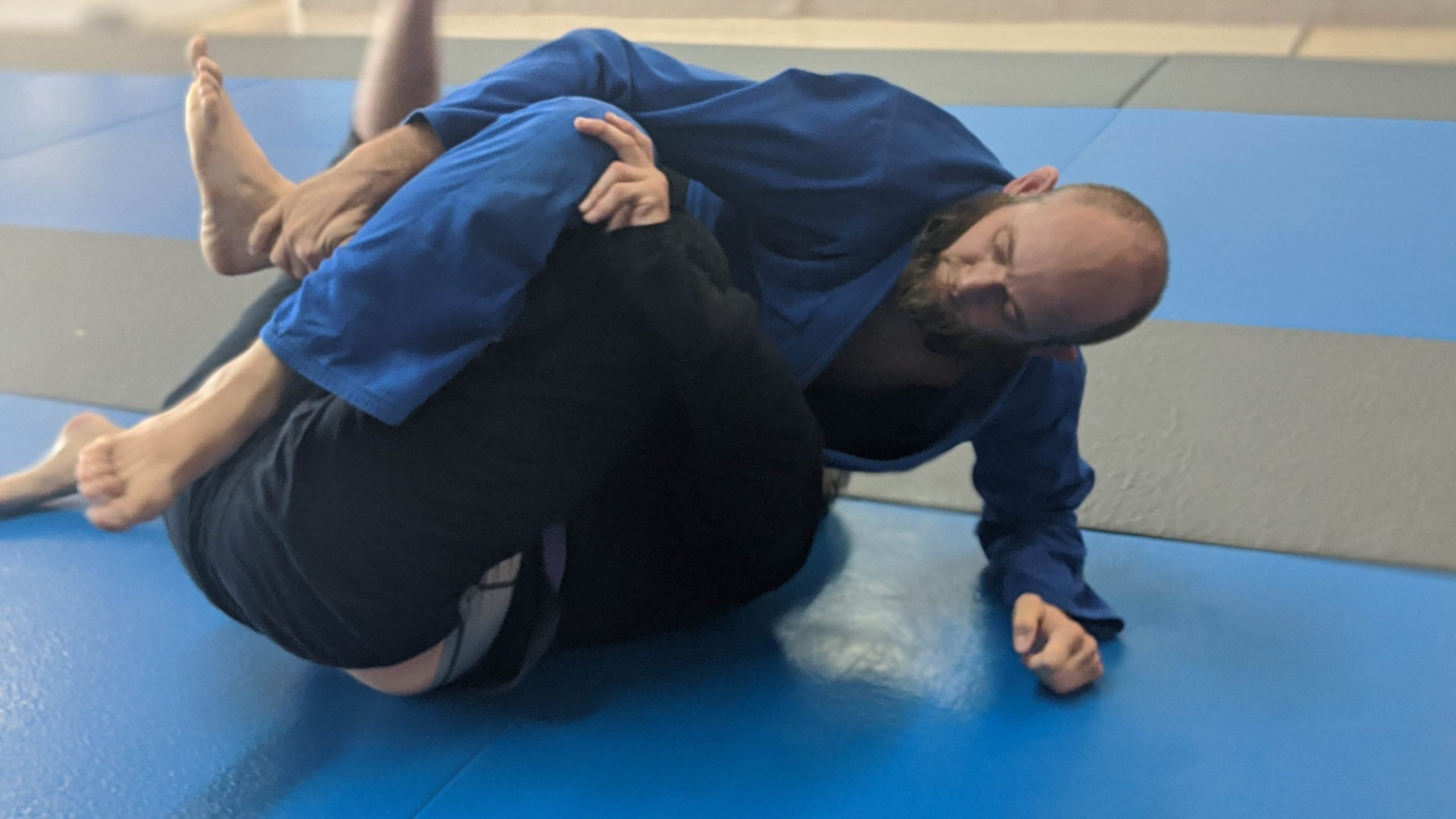 professor lance yager demonstrating brazilian jiu jitsu